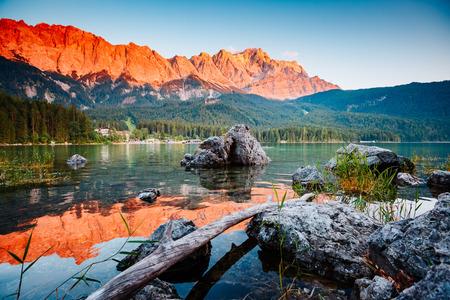 Famous lake Eibsee the best outdoor adventure vacation destinations. Wonderful day gorgeous scene. Location resort Garmisch-Partenkirchen Bavarian alp, sightseeing Europe. Explore the worlds beauty. Stock Photo