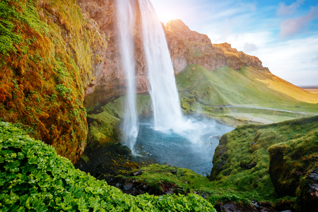 Perfect view of famous powerful Seljalandsfoss waterfall in sunlight. Dramatic and gorgeous scene. Popular tourist attraction. Location place Iceland, sightseeing Europe. Discover the world of beauty  Reklamní fotografie