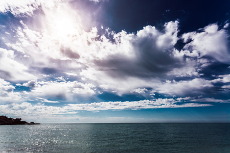 Fantastic view of the azure sea on a sunny day and dramatic sky. Picturesque and gorgeous scene. Location place Island Sicily, Italy, Europe. Artistic picture. Discover the world of beauty. Stock Photo