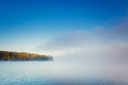 Vivid view of the foggy pond in morning. Dramatic and gorgeous scene. Location place Ternopil, Ukraine, Europe. Discover the world of beauty. Glowing filter. Artistic picture. Vintage effect. 写真素材 - 101293991