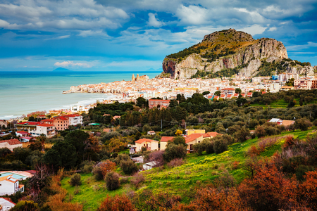 An impressive view of the famous resort Cefalu. Location place Tempio di Diana, Sicilia, Italy, Tyrrhenian sea, Europe. Wonderful day and gorgeous scene. Popular tourist attraction. World of beauty. Stock Photo