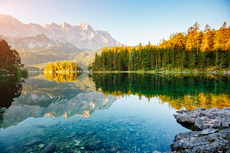 A look at the famous lake Eibsee in sunligth. Picturesque day gorgeous scene. Location resort Garmisch-Partenkirchen Bavarian alp, sightseeing Europe. Best place on earth. Explore the worlds beauty.