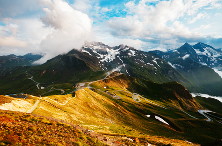 Impressive view of sunlit hills. Picturesque day gorgeous scene. Location place Grossglockner High Alpine Road, Austria. Europe. Outdoor activity. Drone photography. Explore the worlds beauty.