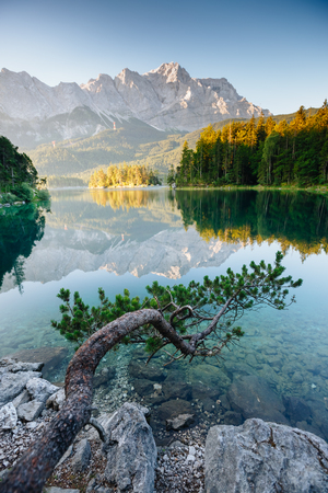 A look at the famous lake Eibsee in sunligth. Wonderful day gorgeous scene. Location resort Garmisch-Partenkirchen Bavarian alp, sightseeing Europe. Best place on earth. Explore the worlds beauty.