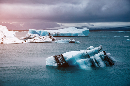 Large pieces of the iceberg. Awesome and striking scene. Location Vatnajokull national park, Europe. Typical Icelandic landscape. Climate change. Unique place on earth. Art photography. Beauty world.