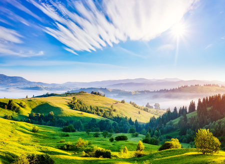 Bright rolling countryside around a farm in the morning light. Picturesque day and gorgeous scene. Location place Carpathian, Ukraine Europe. Wonderful image of wallpaper. Explore the worlds beauty.