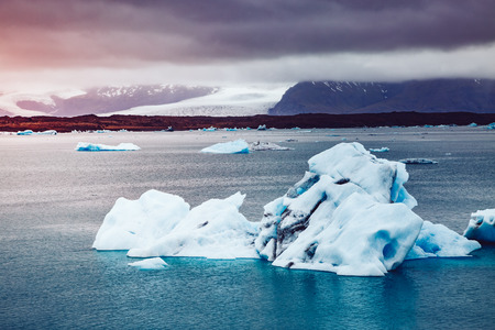 Large pieces of the iceberg. Dramatic scene and picturesque picture. Location place Iceland, sightseeing Europe. Scenic surroundings near the Vatnajokull national park. Explore the worlds beauty.