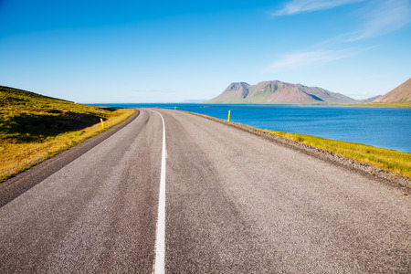 Empty road leading along the coast. Typical Icelandic landscape. Picturesque day and gorgeous scene. Location place island Iceland, Europe. Active outdoor vacation. Explore the worlds beauty.