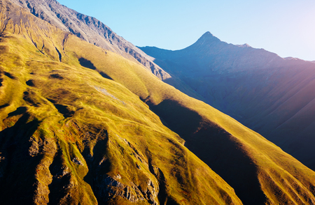 Captivating scene of the main Caucasus ridge. Location place Location place Juta village - foot of Mt Chaukhebi, Georgia country, Europe. Active outdoor vacation. Explore the worlds beauty.  Stock Photo