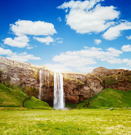 Perfect view of famous powerful Seljalandfoss waterfall in sunlight. Gorgeous day and picturesque scene. Location place Iceland, sightseeing Europe. Unique place on earth. Explore the world's beauty.