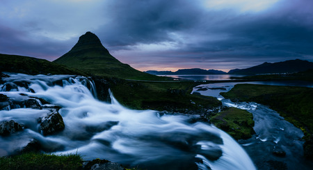 The Kirkjufell volcano the coast of Snaefellsnes peninsula. Fantastic and gorgeous scene. Location Kirkjufellsfoss, Iceland, sightseeing Europe. Unique place on earth. Explore the worlds beauty. Stock Photo