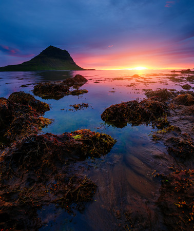 Evening Kirkjufell volcano the coast of Snaefellsnes peninsula. Wonderful image of wallpaper. Discover the worlds beauty.