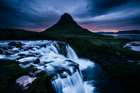 The Kirkjufell volcano the coast of Snaefellsnes peninsula. Fantastic and gorgeous scene. Location Kirkjufellsfoss, Iceland, sightseeing Europe. Unique place on earth. Explore the worlds beauty. 스톡 콘텐츠