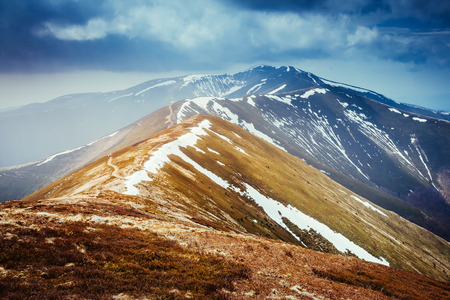 Gloomy view of the snow range under overcast sky. Dramatic scene and picturesque picture. Location place Carpathian, Ukraine, Europe. Discover the world of beauty.