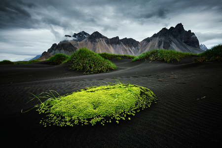 Stunning image of rippled beach black sand. Unique and gorgeous scene.