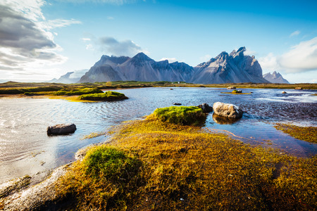 Stunning image of unusual hills glowing by sunlight. Exotic and gorgeous scene. Location place Stokksnes cape, Vestrahorn, Iceland, Europe. Breathtaking wallpaper. Beauty world. Фото со стока - 110900900