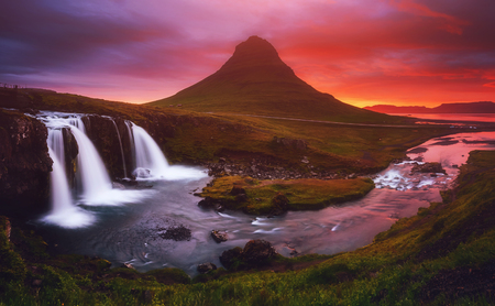 Fantastic image of evening with Kirkjufell volcano the coast of Snaefellsnes peninsula. Picturesque and gorgeous scene. Location famous place Kirkjufellsfoss waterfall, Iceland, Europe. Beauty world. Imagens