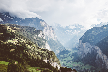 Scenic surroundings near the resort Wengen. Great and gorgeous scene. Famous tourist attraction. Location place Swiss alp, Lauterbrunnen valley, Bernese Oberland, Europe. Discover the world of beauty. Stock Photo