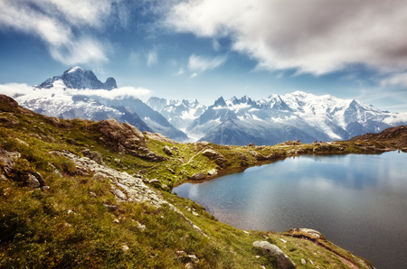 Views of the Mont Blanc glacier with Lac Blanc. Popular tourist attraction. Picturesque and gorgeous scene. Location place Nature Reserve Aiguilles Rouges, Graian Alps, France, Europe. Beauty world. 写真素材 - 114090779
