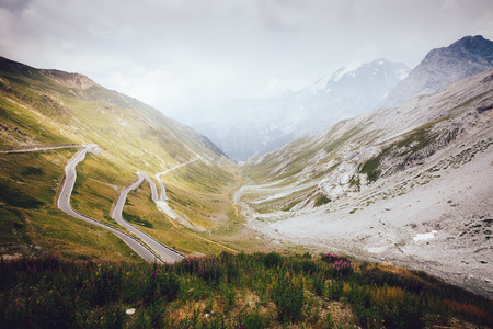 View of the highest paved mountain pass in the Eastern Alps Stelvio. Picturesque and gorgeous scene. Location place of Dreisprachenspitze, South Tyrol, Italy, Europe. Discover the world of beauty. Stock Photo