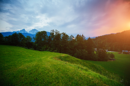 The countryside in twilight. Wonderful and gorgeous scene. Location place Berchtesgaden land Bavaria, Germany alp, famous Watzmann peak, sightseeing Europe. Vacation time. Explore the worlds beauty. 스톡 콘텐츠