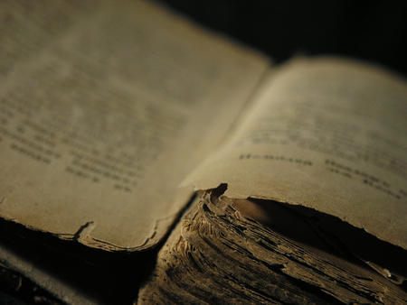 Old book isolated over a black background.