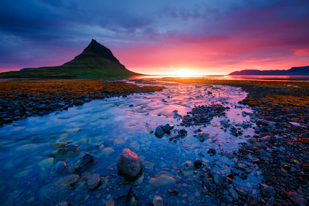 Evening Kirkjufell volcano the coast of Snaefellsnes peninsula. Location Kirkjufellsfoss sightseeing Europe. Typical Icelandic landscape. Breathtaking picture of wildlife. Explore the worlds beauty. Reklamní fotografie