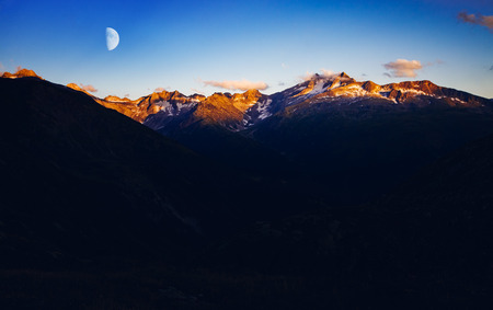 Panorama of snow ridge in twilight. Wonderful and gorgeous scene. Location place Swiss alps, Grimsel pass in the canton of Valais, sightseeing Europe. Drone photography. Explore the worlds beauty.