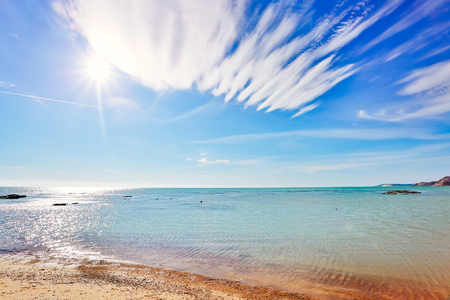 Breathtaking sea with white clouds. Picturesque day and gorgeous scene. Location coast of island Sicilia Italy Europe. Mediterranean climate. Wonderful image of wallpaper. Explore the worlds beauty. Stock Photo