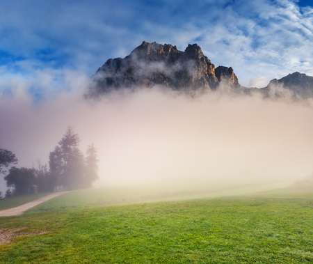 Great view of the foggy Tofane range from Falzarego pass. Picturesque and gorgeous scene. Location place Dolomiti, South Tyrol, Cortina d'Ampezzo. Italy, Europe. Discover the world of beauty.