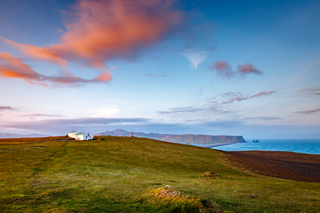 Fantastic views of the magical place on small peninsula. Popular tourist attraction. Dramatic and gorgeous scene. Location place Sudurland, cape Dyrholaey, coast of Iceland, Europe. Beauty world. 스톡 콘텐츠