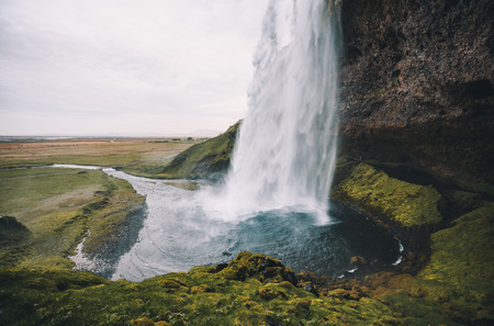 Perfect view of famous powerful Seljalandsfoss waterfall in sunlight. Dramatic and gorgeous scene. Location place Iceland, sightseeing Europe. Reklamní fotografie