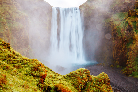 Lovely view of famous Skogafoss waterfall and scenic surroundings. Dramatic and picturesque scene. Popular tourist attraction. Location place Skoga river, highlands of Iceland, Europe. Beauty world. 版權商用圖片