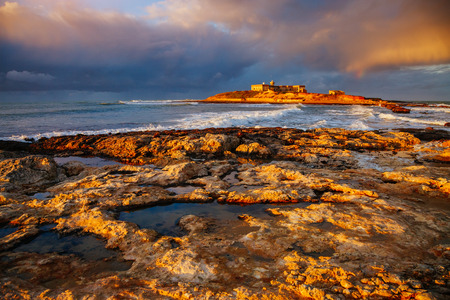 Breathtaking sea and overcast sky. Dramatic morning and gorgeous scene. Location Passero cape, island Sicilia Italy Europe. Climate change. Wonderful image of wallpaper. Explore the world's beauty. Standard-Bild - 116569219