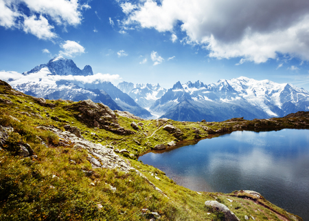 Views of the Mont Blanc glacier with Lac Blanc. Popular tourist attraction. Picturesque and gorgeous scene. Location place Nature Reserve Aiguilles Rouges, Graian Alps, France, Europe. Beauty world. Archivio Fotografico