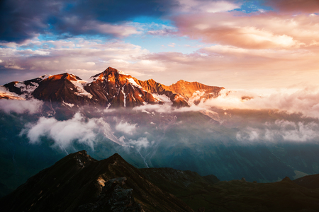 A look at the sunlit hills at twilight. Dramatic evening scene. Location place Grossglockner High Alpine Road, Austria. Europe. Climate change. Popular tourist attraction. Explore the worlds beauty.