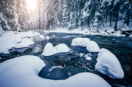 Scenic photo of stormy flow. Frozen stones in frosty day. Location Carpathian Ukraine Europe. Discover the beauty of earth. Adventure vacation. Incredible image of holiday wallpapers. Happy New Year! Stock Photo