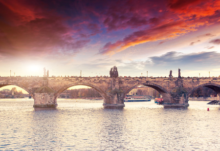Stunning image of Charles bridge (Karluv Most) and lesser town bridge tower on river Vltava. Location place Prague, Czech Republic, sightseeing Europe. Popular tourist attraction. Beauty world. Stock Photo - 120056000