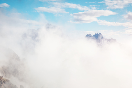 Foggy hill and stunning scene of the alpine valley. Location Dolomiti, South Tyrol, Dramatic day and picturesque image. Climate change. Save environment. Drone photography. Explore the world's beauty. Standard-Bild - 118771625