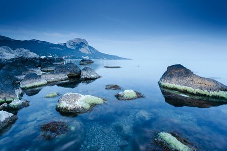 Magical Black sea in the evening light. Breathtaking scene. Location place Crimea, Ukraine, Europe. Blue toning effect. Wonderful image of wallpaper. Art photography. Discover the world of beauty. 스톡 콘텐츠 - 118561540