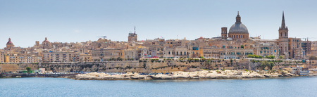 Stunning image of the Basilica Our Lady of Mount Carmel from Sliema. Location place ancient city Valletta, Malta island, sightseeing Europe. Popular tourist attraction. Beauty world. Фото со стока - 120348595