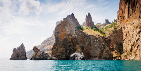 Picturesque mountain range in Crimean peninsula, an ancient extinct volcano. Location Kara Dag (Black Mount), coastal town of Koktebel. Unique place on earth. Explore the world's beauty and wildlife.