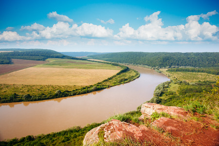 Inspiring image of the sinuous river flowing through hills. Picturesque and gorgeous morning scene. Location place Dnister canyon, Ukraine, Europe. Save environment. Explore the world's beauty. Фото со стока - 120347946