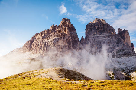 Stunning image of alpine rocky wall. Location National Park Tre Cime di Lavaredo, Dolomiti, South Tyrol, Italy, Europe. Picturesque day and gorgeous picture. Explore the worlds beauty and wildlife. Stock Photo