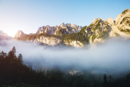 Stunning image of alpine lake Vorderer Gosausee. Picturesque and gorgeous morning scene. Salzkammergut is a located in the Gosau Valley in Upper Austria. Dachstein glacier. Explore the world's beauty. Фото со стока - 120347267