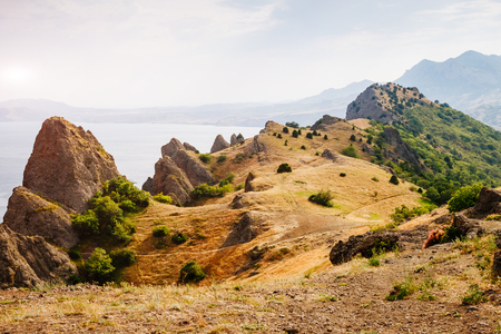 Picturesque mountain range in Crimean peninsula, an ancient extinct volcano. Location Kara Dag (Black Mount), coastal town of Koktebel. Unique place on earth. Explore the worlds beauty and wildlife.