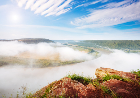Inspiring image of the sinuous river flowing through hills. Picturesque and gorgeous morning scene. Location place Dnister canyon, Ukraine, Europe. Drone photography. Explore the worlds beauty.