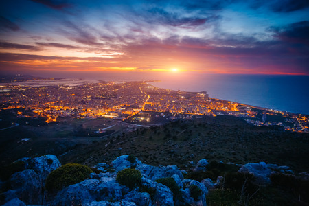 Top view above the city illuminated with lights. Dramatic and picturesque scene. Location place Trapani town, Erice, Sicilia, Italy, Europe. Mediterranean and Tyrrhenian sea. Beauty world. 스톡 콘텐츠 - 120346194