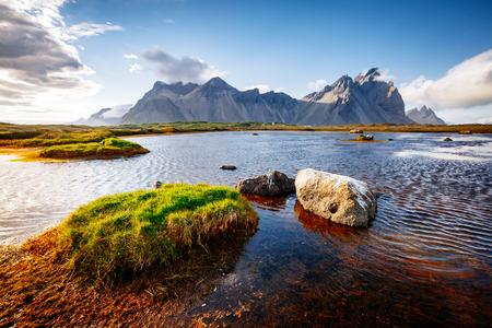 Beautiful mountain landscape on sunny day. Location Stokksnes cape, Vestrahorn, Iceland, Europe. Wonderful image of amazing nature capture. Summer scene. Discover the beauty of earth. Banco de Imagens
