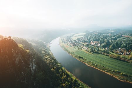 Scenic image of valley Elbe river. Location Saxony Switzerland national park, Rathen, Germany, Europe. Popular tourist attraction. Hiking concept. Adventure vacation. Discover the beauty of earth.